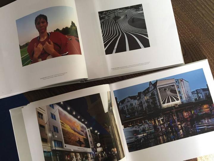 O livro prenda que mostra o trabalho dos fotógrafos